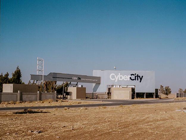 """The entrance to Cyber City, an all-but-abandoned technology park that now houses Palestinian refugees from Syria."" Courtesy NR"